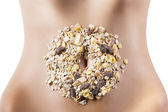 Composition of cereals and dried fruits over belly — Stock Photo