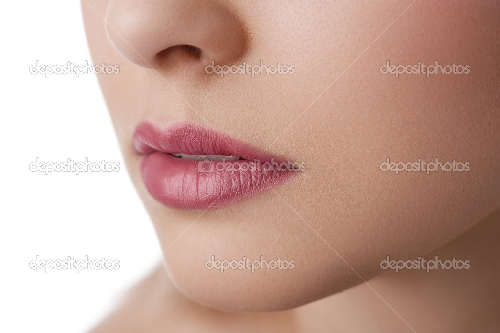 Close up on the lips of a natural beauty model on white — Stock Photo #9480409