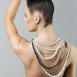 Girl with necklace and hairstyle — Stock Photo