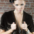 Girl with fur and jewellery - Stock Photo