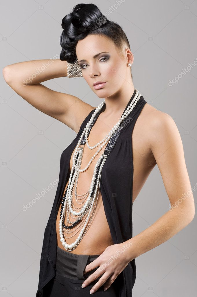 Beautiful sexy brunette with creative hair style wearing open shirt with necklace covering her body — Stock Photo #9570618