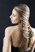 Long hair and fashion hairstyle, her left arm is bent — Stock Photo