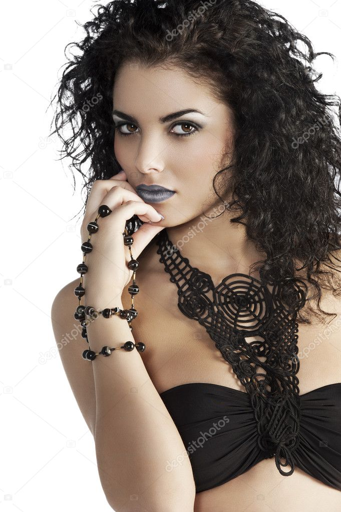 Portrait of young and very beautiful brunette with curly hair wearing a fashion black swimsuit and jewellery — Stock Photo #9743932