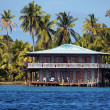 Stilt house and sea — Stock Photo