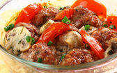 Close up meatballs in a glass pen — Stock Photo