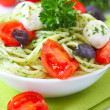 Spaghetti with pesto sauce,cherry tomato and cheese — Stock Photo