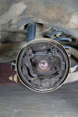 Old brake pads and cylinder brake drum — Stock Photo