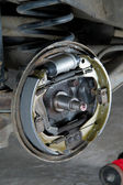 New brake pads and cylinder brake drum — Stock Photo