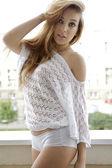 Beautiful brunette girl in a sweater — Stock Photo