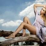 Beautiful blonde woman in white shirt — Stock Photo #10612291