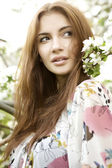 Brunette in the garden — Stock Photo