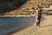Beautiful brunette woman in romantic summer dress — Stock Photo