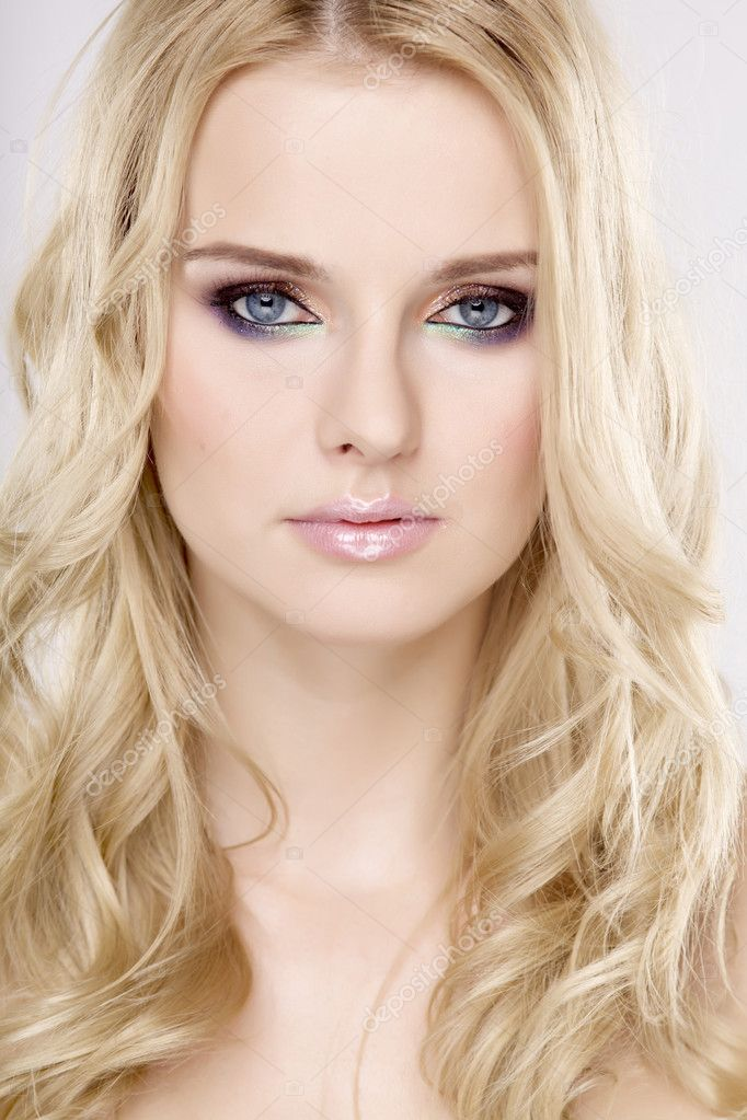 Young pretty woman with beautiful blond hairs and multicolor makeup isolated on white background — Stock Photo #8590576