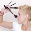 Make-up artist holding brushes — Stock Photo #8753331