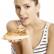 Young beautiful woman eat pizza - Stock Photo