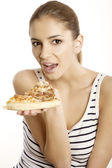 Young beautiful woman eat pizza — Stockfoto
