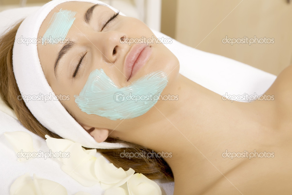 Young woman getting beauty skin mask treatment on her face with brush — Stock Photo #8753397