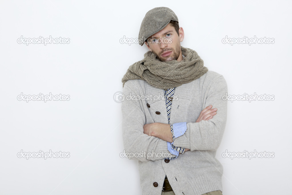 Fashion portrait of handsome young man in a gray sweater isolated on white background — Stock Photo #8753463