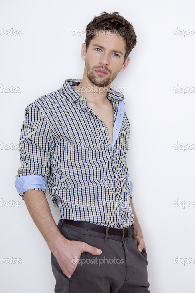 Fashion shot of an elegant young man wearing shirt on grey background — Stock Photo #8753557