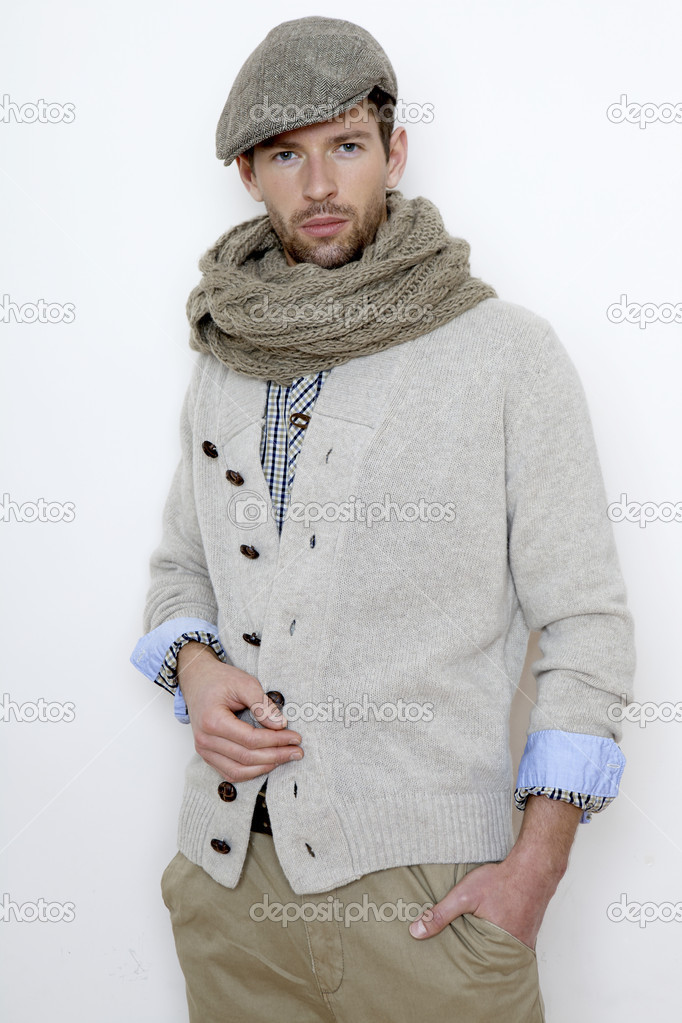 Fashion portrait of handsome young man in a gray sweater isolated on white background — Stock Photo #8753608
