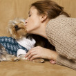 Cute young girl with her Yorkie puppy — Stock Photo