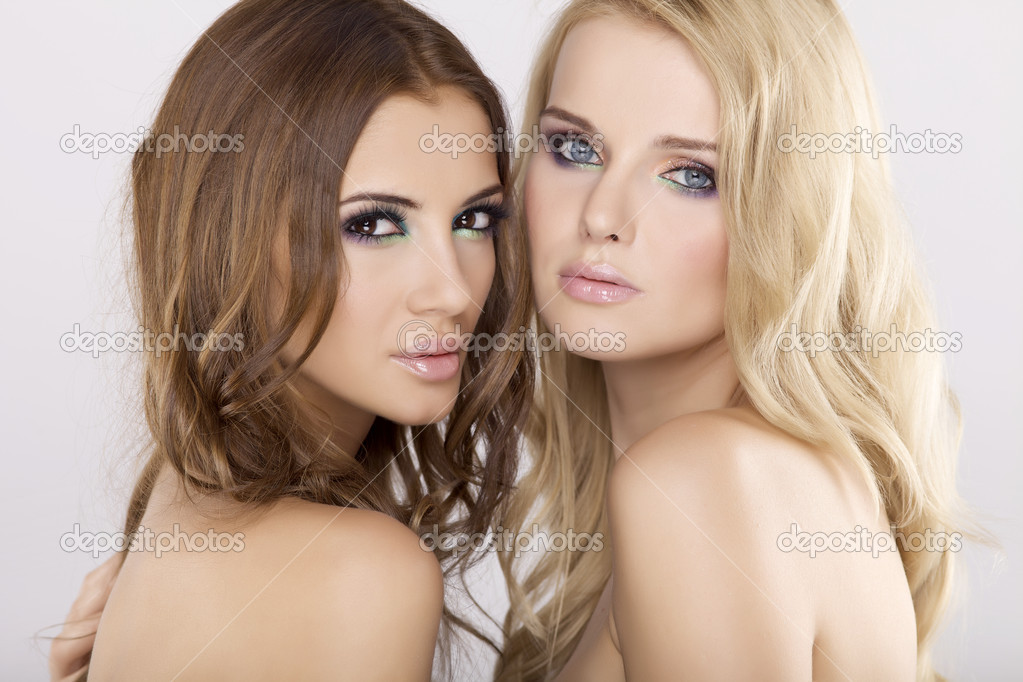 Two attractive girl friends - blond and brunette on white background — Stock Photo #9050902