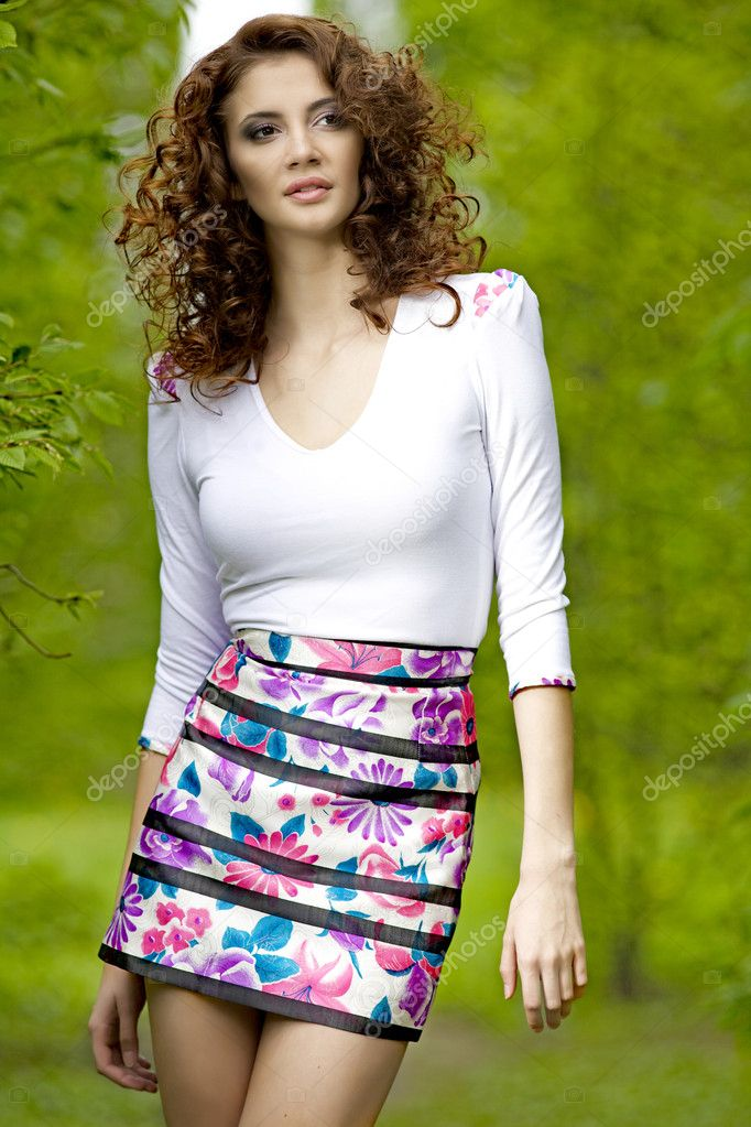 Beautiful brunette in the garden — Stock Photo #9542218