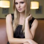 Blond woman in black dress — Stock Photo #9655314