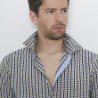 Stock Photo: Fashion shot of an elegant young man wearing shirt