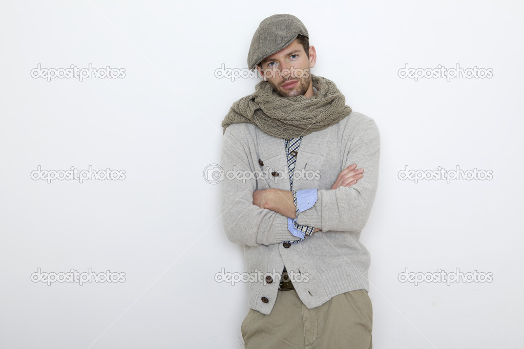 Fashion portrait of handsome young man in a gray sweater isolated on white background — Stock Photo #9983716