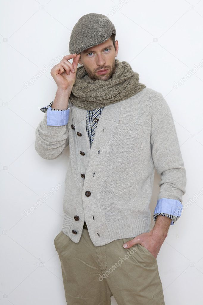 Fashion portrait of handsome young man in a gray sweater isolated on white background — Stock Photo #9983773