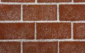 Brick masonry covered with snow. — Stock Photo