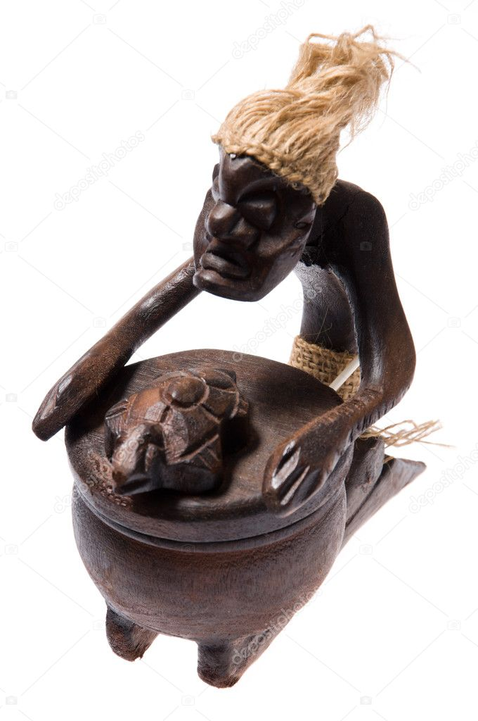 Wooden close ash tray like african shaman figurine isolated on white background.  Stock Photo #8518075