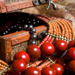 Stock Photo: Close-up old jewelery chest with necklaces placed on scarves