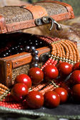 Close-up old jewelery chest with necklaces placed on scarves — Stock Photo