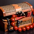 Old jewelery chest with necklaces — Stock Photo