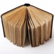 Open old book on white background — Stock Photo