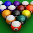 Colorful pool balls over green — Stock Photo