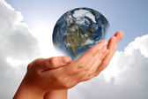 Two hands holding the earth — Stockfoto