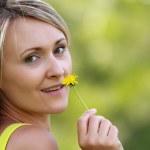 Enjoying outdoors with flower — Stock Photo #10391071