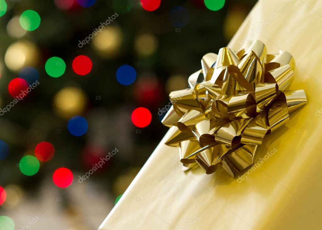 Christmas gift over colorful christmas lights — Stock Photo #8006094