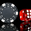 Black poker chip with dice — Stock Photo