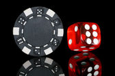 Black poker chip with dice — Stockfoto