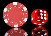 Red poker chip with dice — Stok fotoğraf