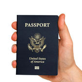 Us passport in hand — Stock Photo