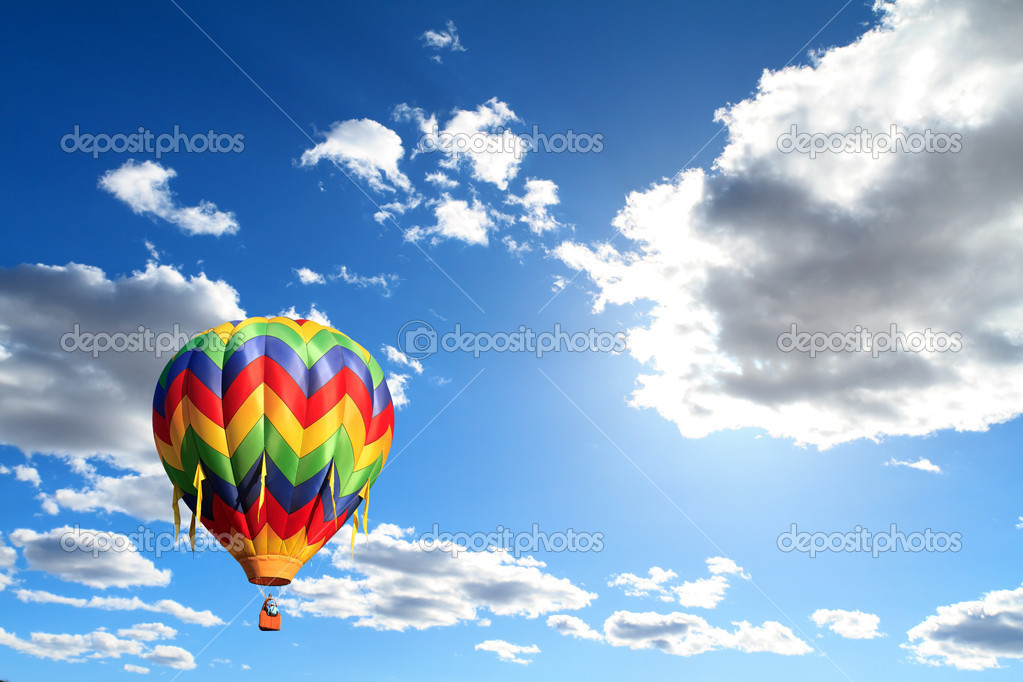 Colorful hot air balloon over cloudy sky — Stock Photo #9960837