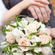 Wedding bouquet and hands with wedding rings — Stock Photo #8518387