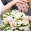 Stock Photo: Wedding bouquet and hands with wedding rings