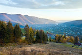 Autumn mountain village and sunrise — Stock Photo