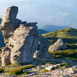 Stony figure on mountain ridge - Stock Photo